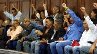 Members of Venezuela's constituent assembly raise their fists