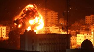 A fireball rises into the sky in Gaza City after a reported Israeli air strike on 25 March 2019