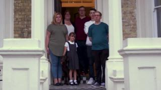 The family outside their home