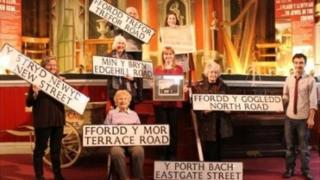 Road signs being held by Friends of Ceredigion Museum members