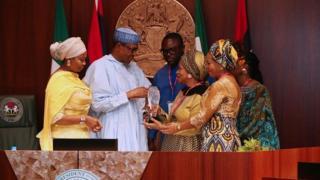 As dem dey give president Buhari di award