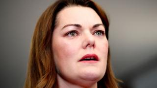 Sarah Hanson-Young with tears in her eyes at a press conference on Monday
