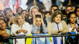 Supporters of National Party presidential candidate Luis Lacalle wait for the results after the second-round presidential election in Montevideo