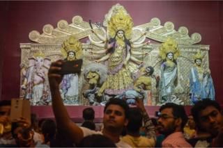 An idol of the Hindu goddess Durga in a sari made out of pure gold