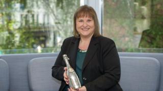 Alison Brittain holding her Veuve Clicquot award