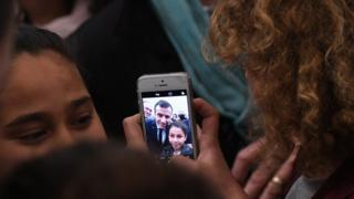 "A Tunisian child takes a selfie with French President Emmanuel Macron during a ceremony in memory of the victims of a deadly Islamic State group attack in 2015 at Tunis"" Bardo Museum on February 1, 2018."