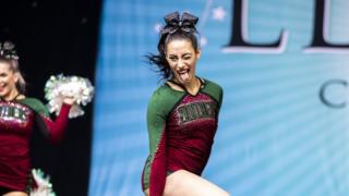 A cheerleader at Legacy Cheer