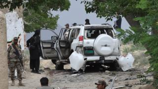 Pakistani security officials examine the site of a powerful explosion in Mastung district, east of provincial capital Quetta on 12 May 2017