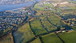 An aerial view of the area near the Foyle River where the houses could be built