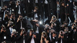 Photographers shooting the red carpet at a Cannes Film Festival