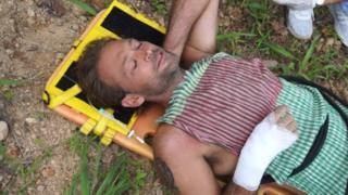 Paul Nicholls on a stretcher