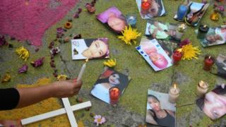 Photos of femicide victims during a protest in Tegucigalpa