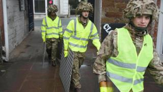 Soldiers from 2Lancs building flood defences in Appleby