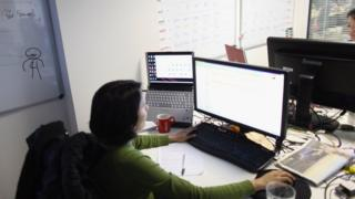 Office worker at her computer screen