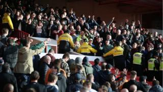 Forest and Derby fans gesture towards each other