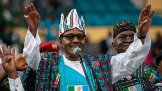 Nigeria president Muhammadu Buhri raise hand for APC rally, 2019