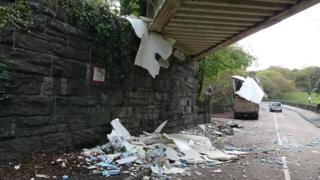 Lorry debris under bridge