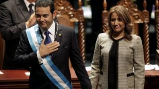 Jimmy Morales, accompanied by his wife Gilda Marroquin, acknowledges after being sworn-in as president in Guatemala City, January 14, 2016.