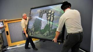 Ken Simons (left) carrying a Magritte
