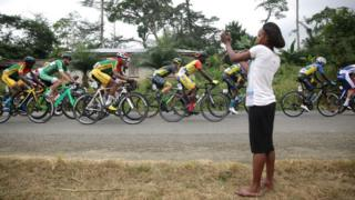 Cyclists on the road in Cameroon