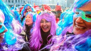Women at a street carnival