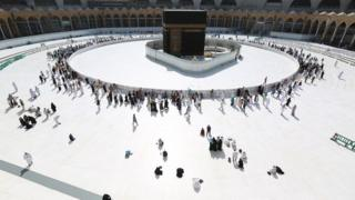 Vastly reduced visitor numbers circle the sacred Kaaba at Mecca's Grand Mosque