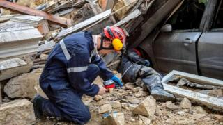 This handout photo released by BMPM/SM shows firemen working and removing rubble at the site where two buildings collapsed, on November 5, 2018 in Marseille