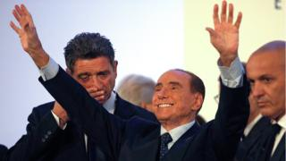 Forza Italia party leader Silvio Berlusconi waves as he leaves at the end of a rally in Catania, Italy, November 2, 2017.