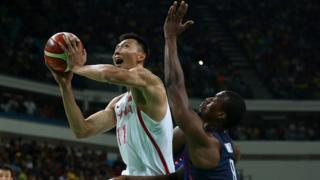 Jianlian Yi of China shoots over Harrison Barnes of United States in the Men's Preliminary Round Group A match on Day 1 of the Rio 2016 Olympic Games at Carioca Arena 1 on August 6, 2016 in Rio de Janeiro, Brazil
