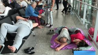 People sleeping in Heathrow Airport