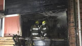 Firefighters in the fire-damaged house