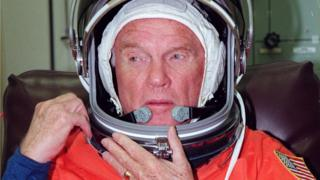 John Glenn suits up at the Kennedy Space Center in Florida prior to his trip to Launch Pad 39-B, 9 October 1998
