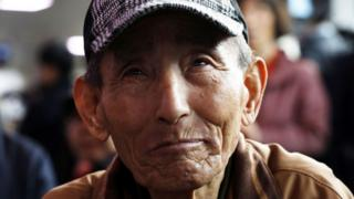 A South Korean man weeps as he watches the April peace summit