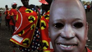 A supporter of the Jubilee Party of Kenya wears a mask of Kenyan President Uhuru Kenyatta as he attends a campaign rally in Nairobi on July 21, 2017 ahead of next month's presidential election.