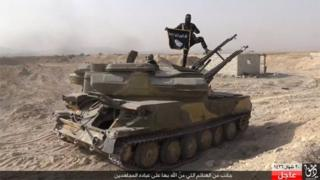 IS fighter on a captured tank in al-Qaryatain (picture by Rased News Network, a Facebook page affiliated with IS via AP - 06/08/15)