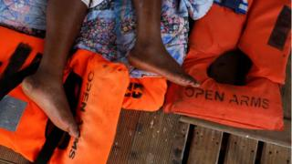 Rescued Cameroonian migrant Josepha, 40-years-old, rests on board the Spanish NGO Proactiva Open Arms boat as it sails back to Spain in the Mediterranean Sea, 17 July 2018