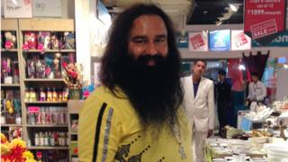 Indian spiritual guru Gurmeet Ram Rahim poses for a photograph after he was spotted at a shopping mall in New Delhi on January 5, 2015