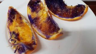 Three orange slices that turned purple