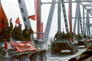 Red Army soldiers cross the Amu Darya river at the Soviet-Afghan border in Termez on February 15, 1989 during Soviet Army withdrawal from Afghanistan. The Soviet Union invaded Afghanistan in December 1979 to shore up the pro-Soviet regime in Kabul and maintained more than 100,000 troops in the country until completing their phased withdrawal in 1989.