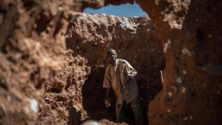 A man searches for cobalt in an old mine