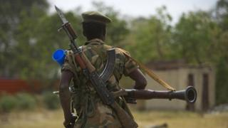 South Sudanese People Liberation Army (SPLA) soldier patrols in Malakal on January 21, 2014.