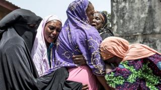 in_pictures Women hug each other in grief in Conakry, Guinea - Sunday 1 March 2020