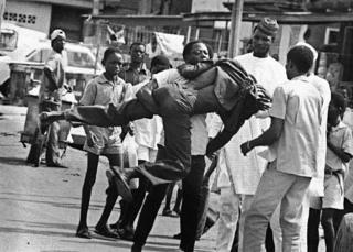 "A photo by Sunmi Smart-Cole entitled: ""Meanwhile In Lagos"" - 1985, showing a street fight"
