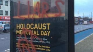 """Poster advertising a Holocaust memorial event in east London daubed with graffiti including the words """"liars"""" and """"killer"""""""