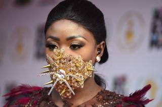 Ghanaian model Nana Akua Addo poses on the red carpet during the All Africa Music Awards in Lagos on November 12, 2017
