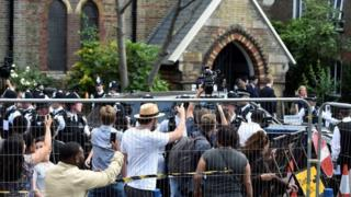 "Image copyright PA A large police presence held back angry crowds outside a Kensington church where Theresa May was meeting victims of the Grenfell Tower disaster.The prime minister faced cries of ""coward"" and ""shame on you"".One woman wept, saying it was because the PM declined to speak to anyone outside the meeting which lasted less than hour.Mrs May pledged £5m of support, housing guarantees and help with access to bank accounts and cash. Laura Kuenssberg: Fragile government facing huge challenge Tower block fires: Did government act on advice? Tower victims 'may never be identified' Live updates: Recovery continues after tower blaze ""The package of support I'm announcing today is to give the victims the immediate support they need to care for themselves and for loved ones. We will continue to look at what more needs to be done,"" Mrs May said in a statement issued by her office. Dozens of demonstrators surged towards the entrance of St Clement's church and t.."