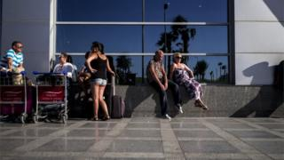 Tourists wait at Sharm el-Sheikh airport