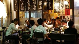 Japanese businessmen drinking at an izakaya (Japanese gastropub) in Yokohama, Japan, on 3 October 2014.