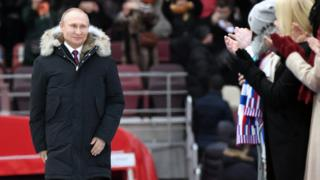 Vladimir Putin is applauded at an election rally in Moscow's Luzhniki stadium on 3 March 2018.