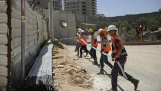 Bridge construction workers